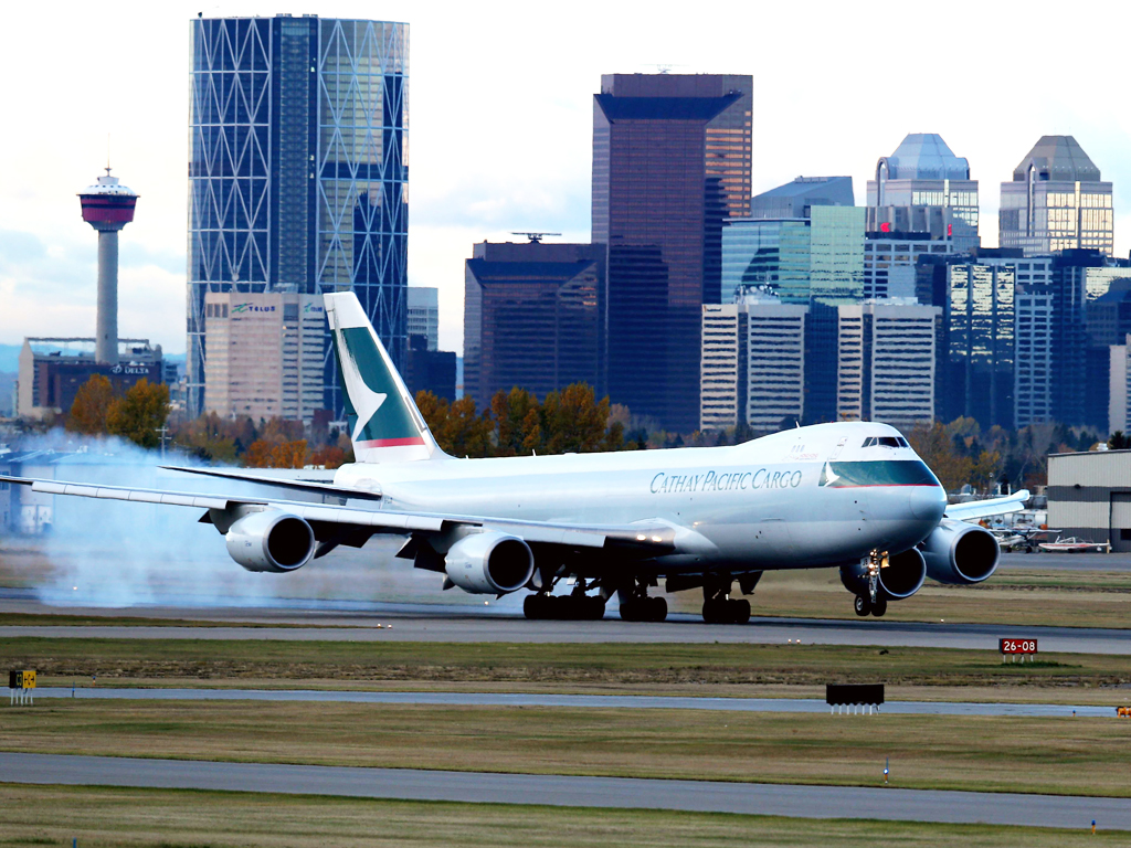 Cargo slump leads Cathay into loss
